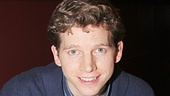 "Sign here! Stark Sands gives a knowing grin as he gives an autograph to ""himself."""