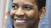 Denzel Washington beams on press day.