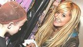 Can I have your autograph, please?Tisdale signs the chart-topping soundtrack of High School Musical for Braun.