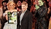 A proud Stephen Schwartz shows off his record-breaking record as Glinda (Katie Rose Clarke) and Elphaba (Mandy Gonzalez) cheer him on.