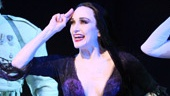 Bebe Neuwirth as Morticia and cast in The Addams Family.