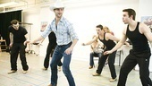 Kyle Dean Massey shows off his best boot-scootin' boogie as Billy Ray Jackson, backed by a lineup of Buckaroos.