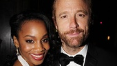 Anika Noni Rose gets close to Best Featured Actor winner John Benjamin Hickey.