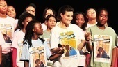 Idina Menzel holds hands with the young ladies who experienced a week of musical theater magic thanks to the Tony winner and her husband, Taye Diggs.