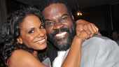 Audra McDonald cozies up to co-star Phillip Boykin, who plays Crown.