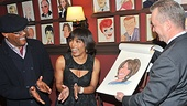Free at last! Sardi's head honcho Max Klimavicius receives a standing ovation from Samuel L. Jackson and a delighted Angela Bassett as her carricature is unveiled.