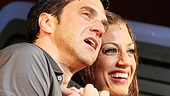 Raúl Esparza and Jessica Phillips hold each other close onstage on opening night of Leap of Faith.