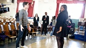 A teacher demonstrates the Guys and Dolls choreography for guest director Nick Jonas.
