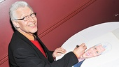 Tony Sheldon signs his picture before it finds its place on Sardi's famous walls.