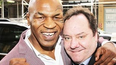 Mike Tyson shows off his fighting spirit with Undisputed Truth producer James L. Nederlander outside the Longacre Theatre.