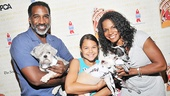 Porgy and Bess stars Norm Lewis and Audra McDonald bookend Audra's daughter Zoe backstage with three adorable dogs.  Catfish Row can use some pets, right?