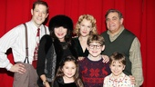 Joan Collins and Eva get a warm family greeting from A Christmas Story's Parker clan: John Bolton, Erin Dilly, Johnny Rabe, Dan Lauria and Zac Ballard.