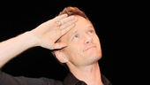Neil Patrick Harris gives a salute the admiring audience.