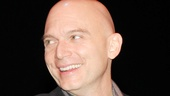 After re-creating his Tony-winning Assassins performance, Evita star Michael Cerveris flashes a smile.