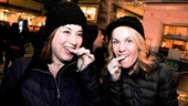 Smile, ladies! Once cast member Anne L. Nathan and A Christmas Story's Erin Dilly, who have been friends for more than a decade, check their teeth before posing for photos at the Christmas shops at Columbus Circle.