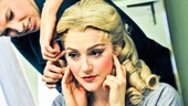 Betsy Wolfe gets a little help with her wig as she prepares to make her rap debut.