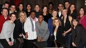 Cheers! A happy group shot of the Tony-winning Nine company. 