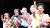 The cast of Vanya cheers as Sigourney Weaver delivers flowers to Christopher Durang in the audience.