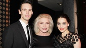 Cory Michael Smith and Emilia Clarke flank Blondie singer Debbie Harry, who hosted the evening's black-and-white-themed bash.