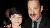 It's a touching moment as Tom Hanks poses with Mike McAlary's young son Quinn.