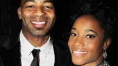 Leading duo Brandon Victor Dixon and Valisia LeKae show off a Motown record at the party.