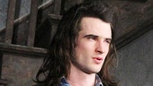 Tom Sturridge has an emotional moment during the curtain call.