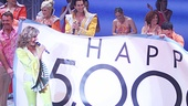 Happy 5,000th performance, Mamma Mia! star Judy McLane and the cast bring out a giant banner at the musical's curtain call.