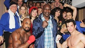 The boxing legend takes a snapshot with the cast of Rocky.