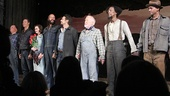 The Of Mice and Men cast takes a company bow.