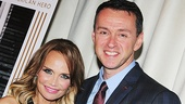 Tony winner Kristin Chenoweth and I Am Harvey Milk composer Andrew Lippa strike a pose in front of a photo of the man himself, Harvey Milk.