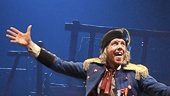 Gavin Lee as Thenardier and the cast of Les Miserables. Photo by Matthew Murphy
