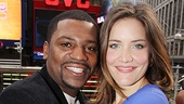 Onstage sweethearts Mekhi Phifer and Rosie Benton look radiant against this New York backdrop.