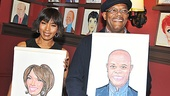 Double trouble! Angela Bassett and Samuel L. Jackson proudly flaunt their brand new caricatures.