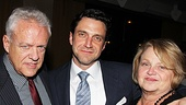 Flanked by his proud parents, Raúl Esparza gives the camera a sweet grin.