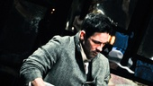 Star Steve Kazee keeps a low profile as he enters the stage during the rousing pre-show concert, near his fellow musician and castmate Andy Taylor. 