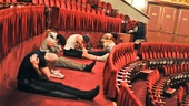 The cast gets together for a meditative yoga session in the theater's mezzanine.