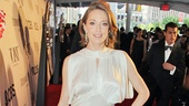 Carrie Coon is serving old Hollywood glamour in this  vintage ivory 1930s evening gown and rhinestone bracelet.