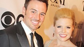 Stage couple Brian Gallagher and Megan Hilty cozy up on the red carpet.