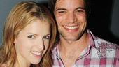 Anna Kendrick and Jeremy Jordan share a clink of glasses. Cheers!