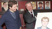 Stark Sands approves of his portrait, presented by Sardi's managing partner Max Klimavicius.