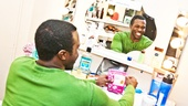 Candy break! Joshua Henry settles down at his dressing table.