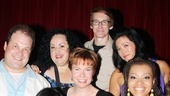 Original Avenue Q cast members Jordan Gelber, Ann Harada, Aymee Garcia, Jennifer Barnhart, Rick Lyon, Erin Quill and Carmen Ruby Floyd smile for the camera.