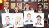 The whole gang lines up with their portraits. Congrats!