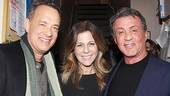 Tom Hanks and Rita Wilson smile with Sylvester Stallone.