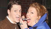 Kinky Boots players Andy Kelso and Jennifer Perry test the authenticity of the silver medal.
