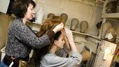 Girls in Jersey Boys  Heather Ferguson putting on wig