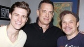 Broadway stars Aaron Tveit and Norbert Leo Butz  grin as they flank Oscar winner Tom Hanks.