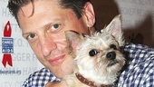 Matilda's Christopher Sieber pets a cute puppy.