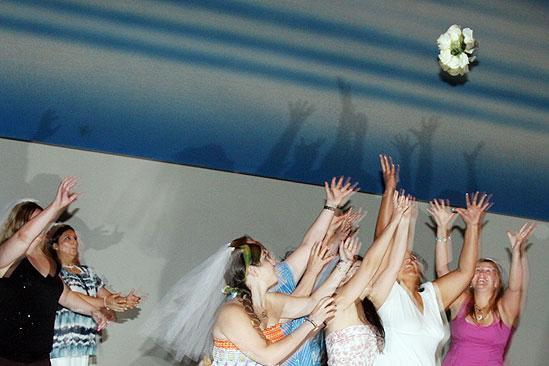 Mamma Mia 15th Longest Running Show - brides catching bouquet