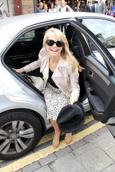Christie Brinkley Does Chicago in London – Christie Brinkley (exit car)